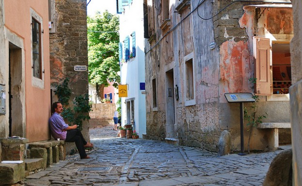 Man relaxes on a Croatian sidestreet, photo by zolakoma on Flickr. (Creative Commons.)